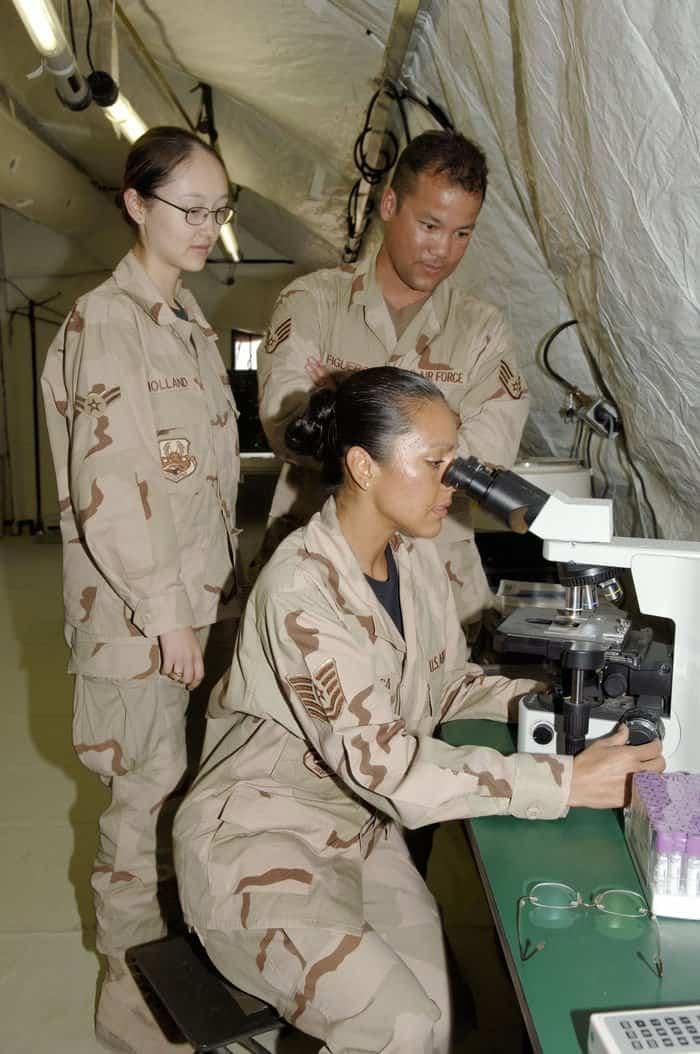 Tech. Sgt. Yvonne Espinosa and Staff Sgt. Francisco Figueroa, EMEDS team lab technicians, read a blood smear