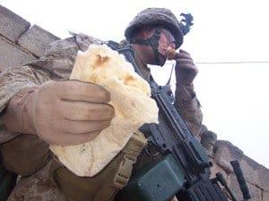 Lance Cpl. Tristain S. Vittorelli enjoys a piece of Iraqi flatbread