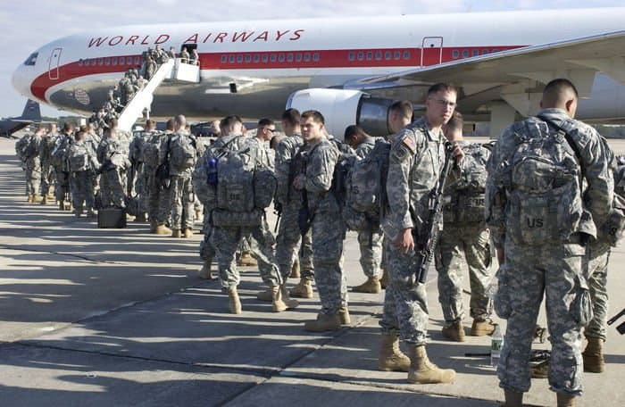 2BCT Paratroopers, 82nd Airborne Division, board a plane to Kuwait