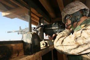Cpl. Hugo J. Delgado Hernandez scans his area of observation outside Camp Fallujah