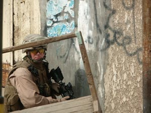 Navy Petty Officer 3rd Class Steven Wimmer provides security for his fellow Marines of the PSD.