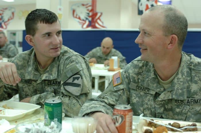 The father son duo of Master Sgt. John Conner, an Infantryman with 4BCT, 25 ID, and Pfc. Jeremy Conner, an Infantryman with 4BCT, 1st Cavalry Division eat dinner together on FOB Marez.