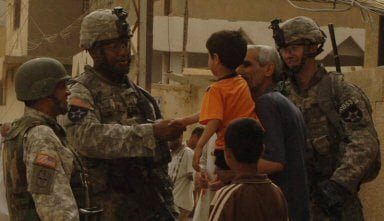 iCompany commander Capt. Antony Gore talks to a family in Baqubah, Iraq.
