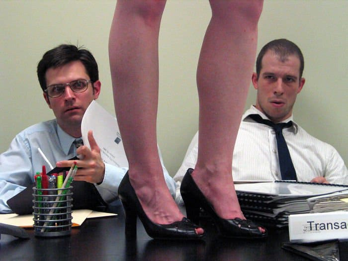 The audit team struggles to keep to the task while one member recreates a drunken dance from the night before.