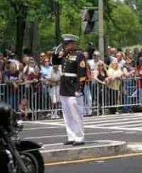 Marine SSgt Tim Chambers, standing on the median for 45 minutes, unwavering, saluting the Rolling Thunder/Gathering of Eagles II Rally
