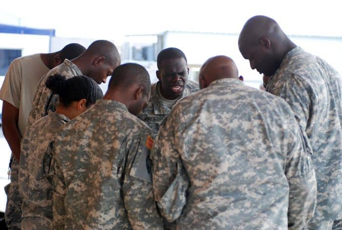 Soldiers of the Gospel Service Choir gather for a prayer before performing at Worshipalooza, an outdoor music concert for Soldiers, Airmen and civilians at FOB Warrior, Kirkuk, Iraq.