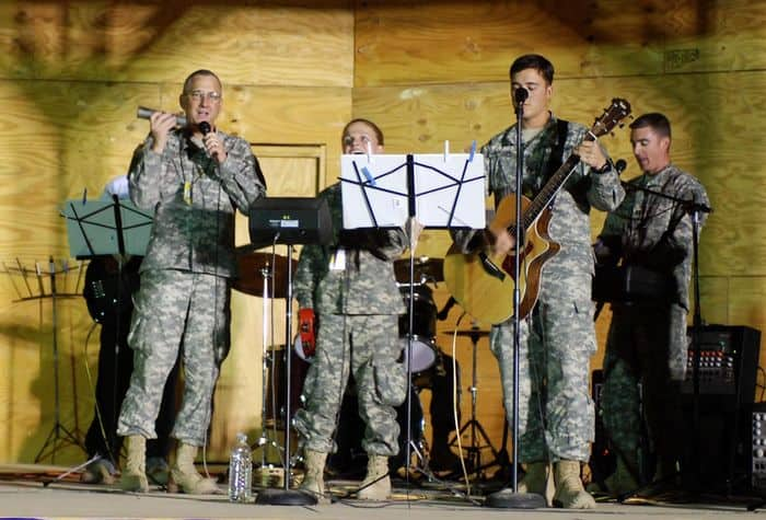 Chaplain Maj. Scott Sterling, brigade chaplain, 3rd Infantry BCT, 25th ID, and members of the Ohana Chapel Praise Team perform at Worshipalooza, outdoor music concert.
