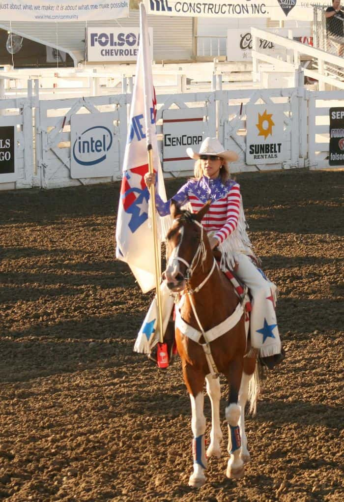 Cowgirls ride in formation at The Folsom Pro Rodeo.