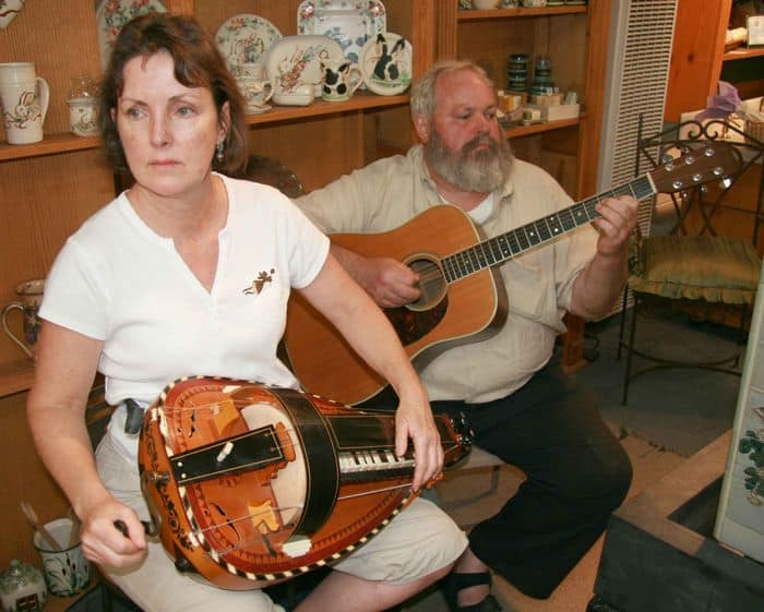 Penny and GF Cloud, playing a french music duet, on Vielle a roue and acoustic guitar at Clouds porcelain.
