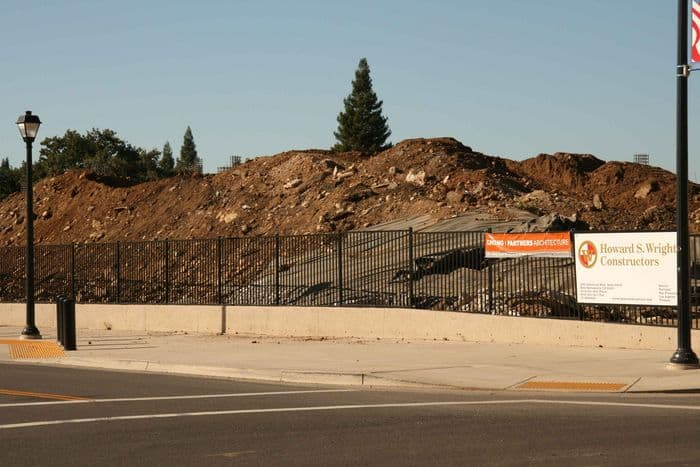 Mound of dirt on the parking garage site, now partially uncovered in preparation for use as backfill.