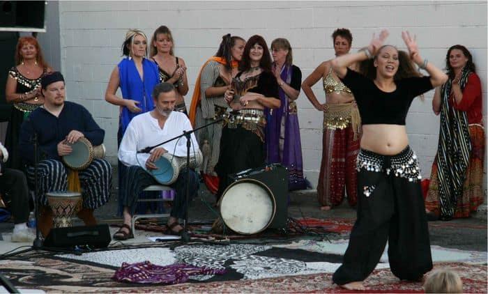 Bellydancers enjoy the funky dancing at Thursday Night Market.
