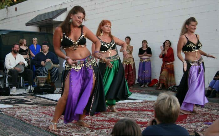 Synchronized belly dancing lights up the crowd.