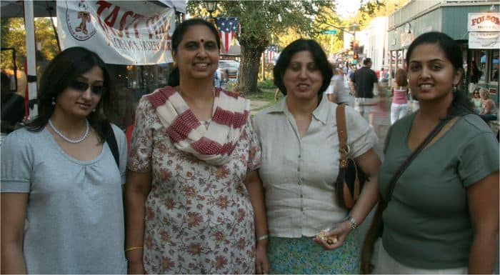 Indian girls enjoy the walk down Sutter Street, at the Thursday Night Market.