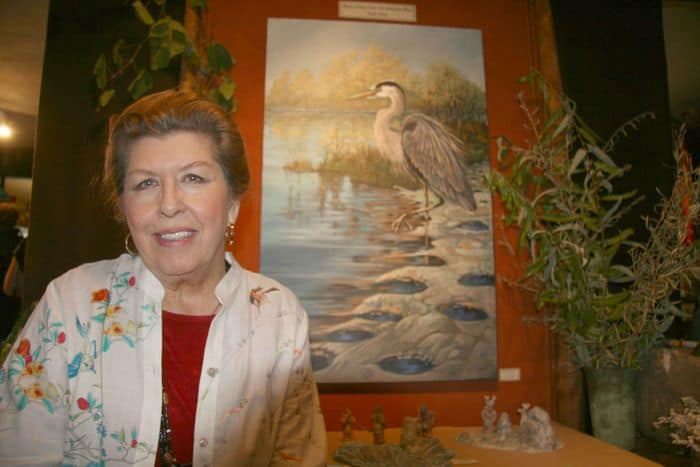 Gayle Anita, noted wildlife artist with one of her works.