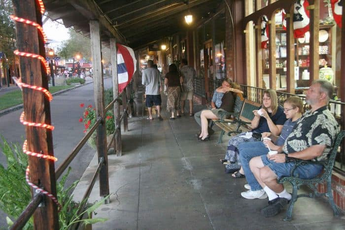 The band outside Pacific Western Traders, above Snooks Candies.
