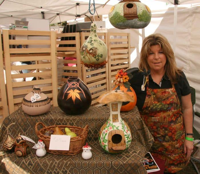A gourd artist shows visitors how to shape and prepare a gourd for painting at Folsom Gourd and Arts Festival.
