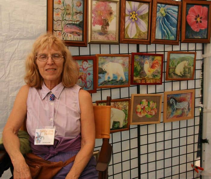 A handbag artist shows off her decorative work at Folsom Gourd and Arts Festival.