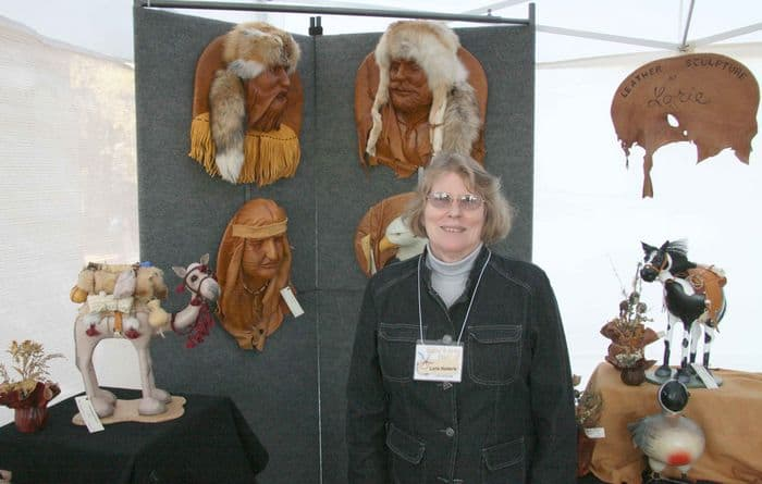 Lorie the leather artist with her leather sculptures.