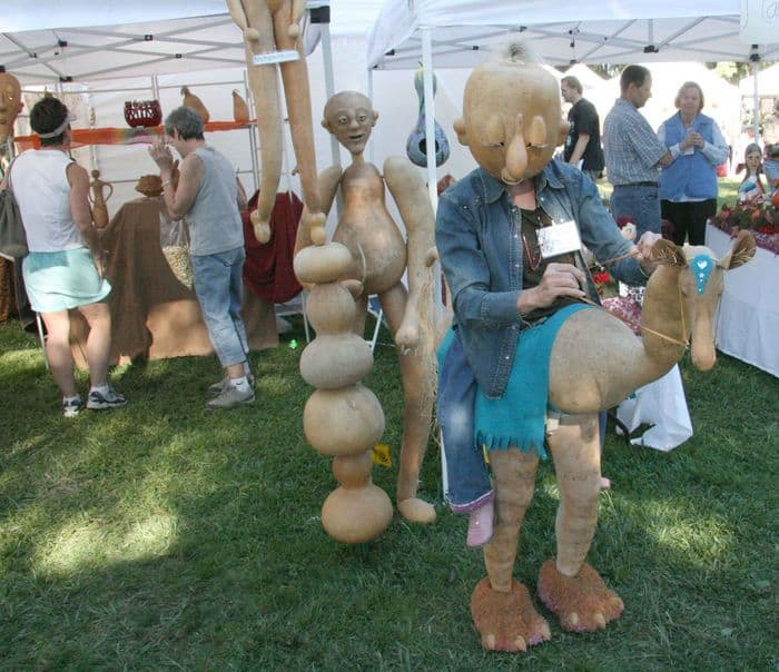 The gourdhorsewoman interacts with visitors at Folsom Gourd and Arts Festival.