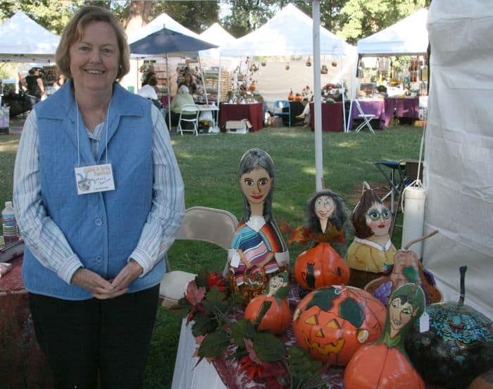 Artist with her intricate gourds at Folsom Gourd and Arts Festival.