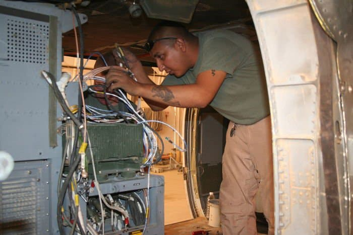 25th Combat Aviation Brigade Soldiers install the Army Airborne Command and Control System into a UH 60 airframe.