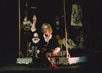 Charley as Hamlet in the 2002 revival, where a miniature carousel was built on the stage.