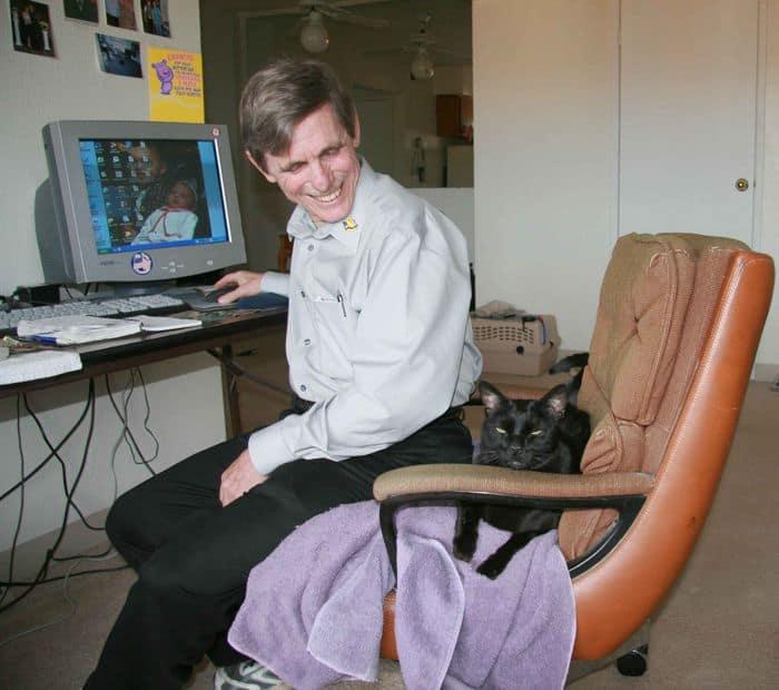 Rainbow coaching Bob at the computer.