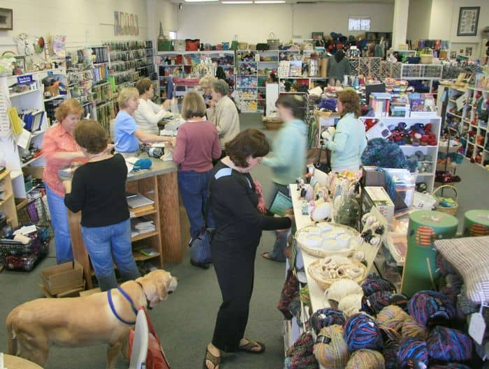 Action at the front counter, while Jack the Yarn Dog keeps order.