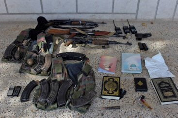 Three AK47s, AK 47 magazines, a RPK rifle, a pistol and grenades taken from an al Qaeda in Iraq safehouse south of Hussein Hamadi village, Iraq, raided by Coalition Forces in Operation Ultra Magnus.