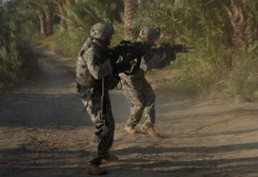 Cpl. Adam Margio and Spc. Randy Stevens engage al Qaeda in Iraq operatives who fired on them from trees near an insurgent safehouse south of Hussein Hamadi village, Diyala Province, Iraq.