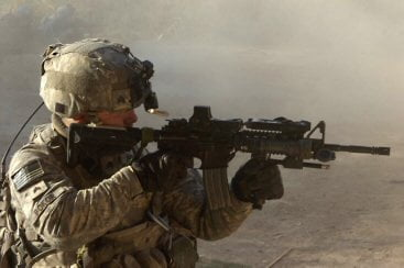 Sgt. David Bokor, Alpha Section team leader fires at al Qaeda in Iraq operatives near an insurgent safehous.