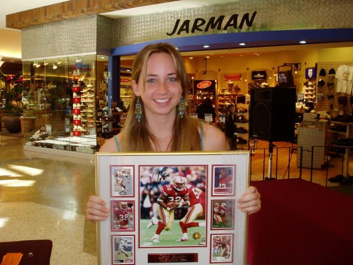 A happy collector at Sunrise Mall free memorabilia drawing.