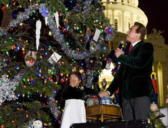 Governor Arnold Schwarzenegger joins eight year old Itzamaya Nunez lighting the Christmas tree at the 76th Annual State Capitol Christmas Tree Lighting Ceremony.