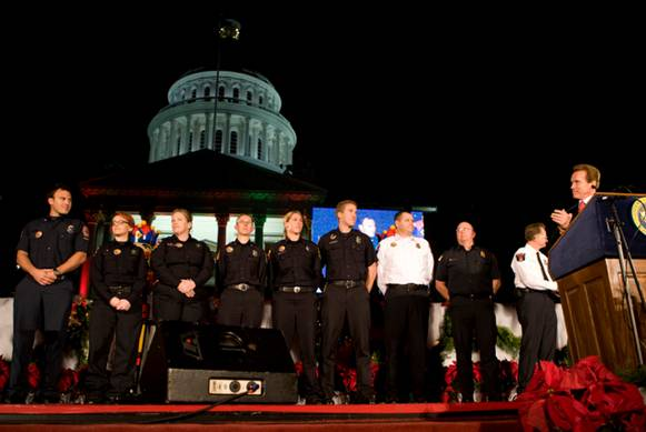 Governor Arnold Schwarzenegger honors California firefighters at the 76th Annual State Capitol Christmas Tree Lighting Ceremony.