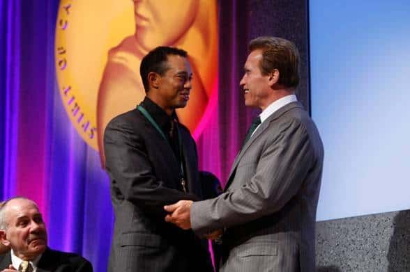 Governor Arnold Schwarzenegger awards the Spirit of California medal to Tiger Woods.