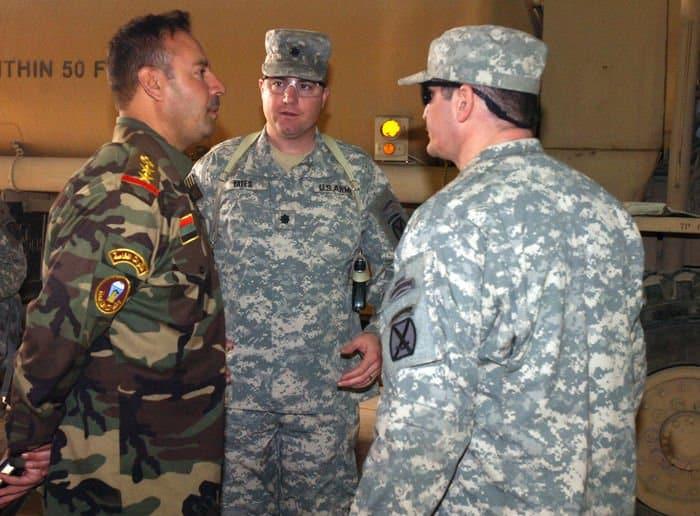 Col. Ahmed Ehbrahim Bedor, battalion commander, speaks with Lt. Col. Dennis Yates, battalion commander.