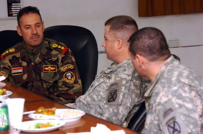 Lt. Col. Dennis Yates, Chesterfield, N.J., a 10th Mountain Division battalion commander, has lunch with Iraqi battalion commander Col. Ahmed Ehbrahim Bedor, to discuss key issues and plans for Zafaraniya