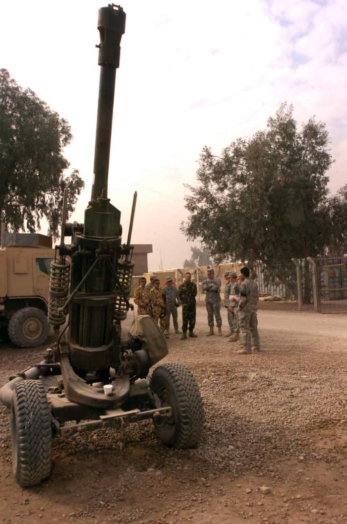 Leaders of 5th Battalion, 25th Field Artillery Regiment, 4th Infantry BCT, 10th Mountain Division and 1st Battalion, 4th Brigade, 1st Iraqi Army Division stand near an M119 howitzer as they tour FOB Rustamiyah.
