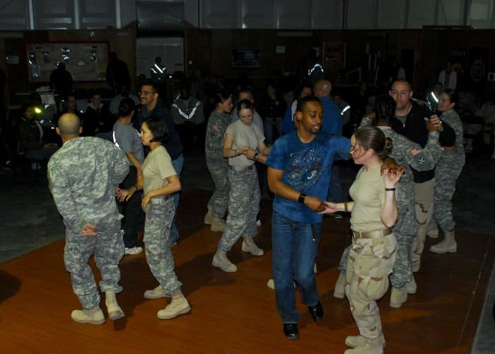 Members of the Armed Forces and civilians deployed into Iraq gathered around at the Division Morale, Welfare and Recreation tent to and enjoy the Latin rhythms of Ritmo Latino ensemble.