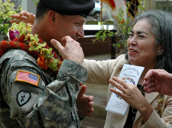 Christina Kemmer, Civilian Aide to the Secretary of the Army for Hawaii, presents Lt. Gen. Benjamin R. Mixon, commanding general, United States Army, Pacific, with a lei after the change of command ceremony.