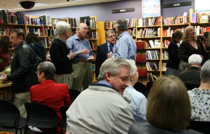 Friends chat prior to the Altar Boys book party.