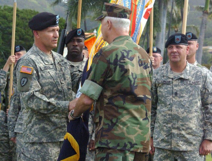 Lt. Gen. Benjamin R. Mixon receives the USARPAC Colors from Adm. Timothy J. Keating, commander, U.S. Pacific Command, during the change of command ceremony held on historic Palm Circle.