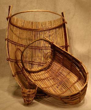 Traditional Pomo Baby Carriers made from peeled and unpeeled willow, handmade dogbane twine and cordage by Luwana Quitiquit.