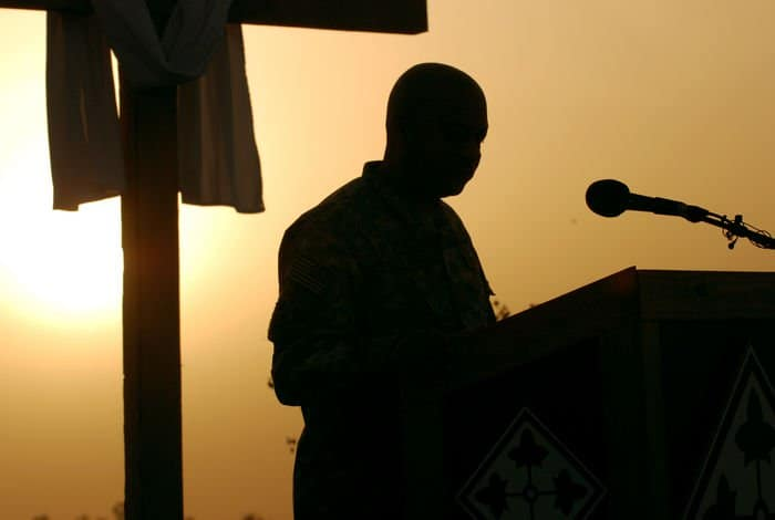 Chaplain Maj. Daryll Hollowell, the deputy chaplain for MND B and 4ID, offers the opening prayer for Easter sunrise services March 23 at Camp Liberty, Iraq.