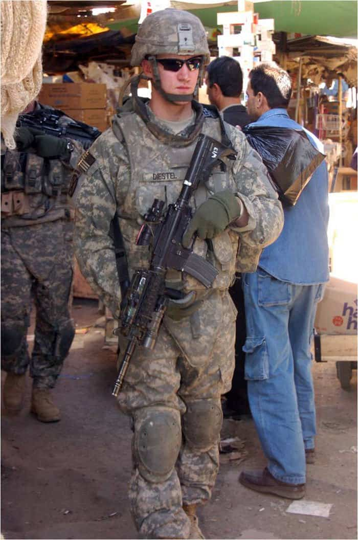 Pfc. Travis Diestel weaves through a local market while on patrol in central Baghdad.