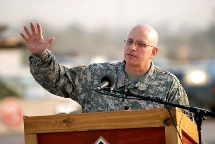 Chaplain Lt. Col. James Carter, division chaplain for 4ID and MND B, offers words of worship during Easter sunrise services March 23 at Camp Liberty, Iraq.