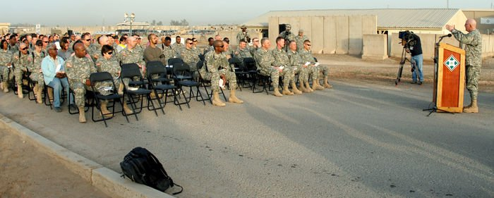 MND B Soldiers listen to words of inspiration from Chaplain Lt. Col. James Carter, division chaplain, 4ID and MND B,during Easter sunrise services March 23 at Camp Liberty, Iraq.