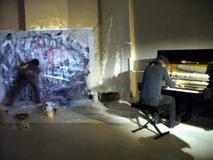 Naoki Iwakawa and Carlo Altomare in Excavation, an action painting event.