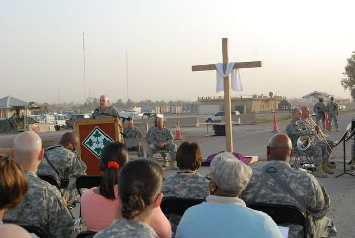 MND B Soldiers listen to words of inspiration from Chaplain Lt. Col. James Carter, division chaplain, 4ID and MND B, at Easter sunrise services in Camp Liberty, Iraq.