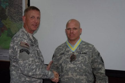 U. S. Army Col. Alfred Dochnal presented U.S. Army Sgt. 1st Class Tim Leckie, convoy security platoon sergeant the prestigious Order of Saint Maurice infantry medallion of the Centurion level for outstanding contributions to the infantry.
